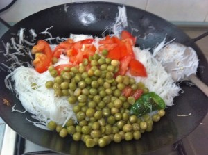 add tomato green peas and salt 300x223 White Bee hoon with Vegetables & Egg